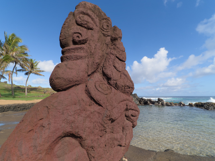 A Rapa Nui styled sculpture decorates a mini beach in Hanga Roa.